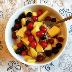Organic Kosher Steel Cut Oatmeal porridge topped with fresh fruit